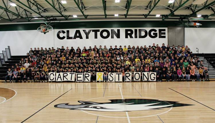 Student Body holding Carter Strong Sign